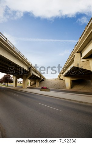 A crossing of two highways with a concrete overpass - stock photo