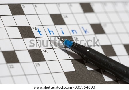 A crossword puzzle saying 'think'. An image of a pencil against an empty crossword puzzle. Crossword puzzles are excellent training for brains. - stock photo
