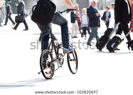A crowd moving against a background of an urban landscape. Young people. Motion blur. - stock photo