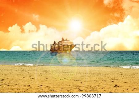 A cruise ship near the coast during sunset - stock photo