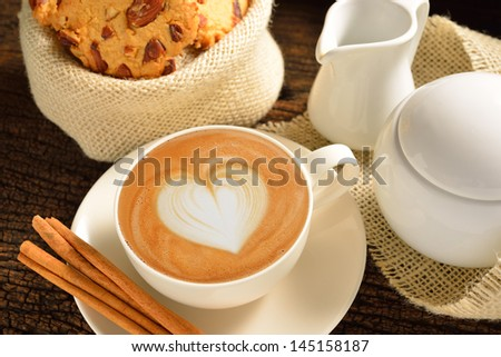 A cup of cafe latte and cookies - stock photo