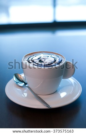 A cup of cappuccino with chocolate - stock photo