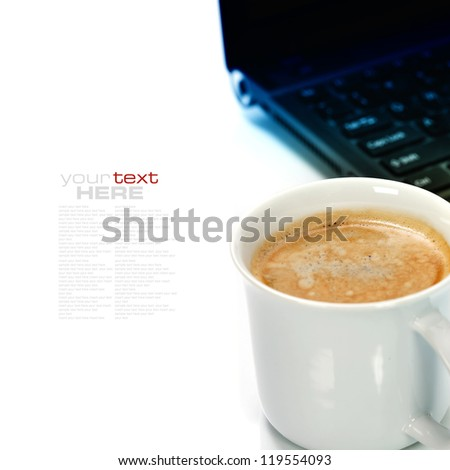 A cup of coffee and laptop over white (with sample text) - stock photo