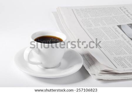 A cup of coffee and newspaper on white background. - stock photo