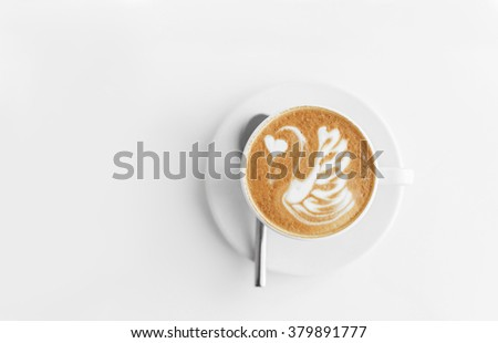 A cup of coffee in a white cup on white background - stock photo