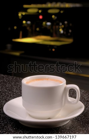 A cup of coffee is on the table in the cafe - stock photo