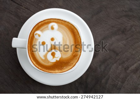 A cup of coffee latte art like bear face - stock photo