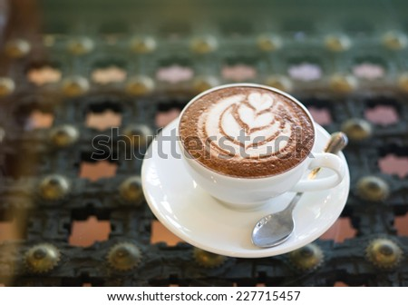 A cup of coffee on table - stock photo
