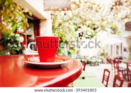 A cup of coffee on table, mediterranean style, Athens, Greece - stock photo