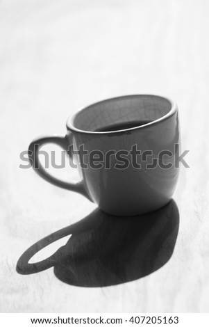 A cup of coffee on the pine wood  - stock photo