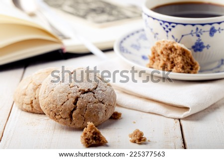 A cup of coffee with cookies and day planner, organizer and postcard. Breakfast table. - stock photo