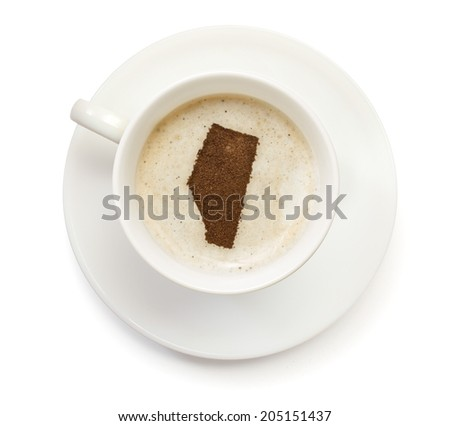 A cup of coffee with foam and powder in the shape of Alberta.(series) - stock photo