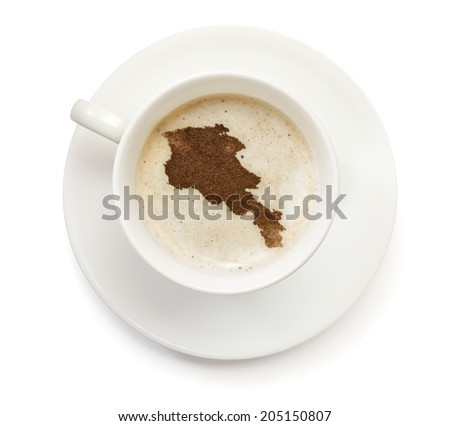 A cup of coffee with foam and powder in the shape of Armenia.(series) - stock photo