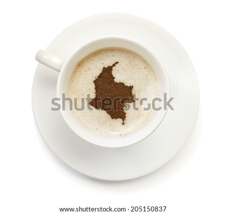 A cup of coffee with foam and powder in the shape of Colombia.(series) - stock photo