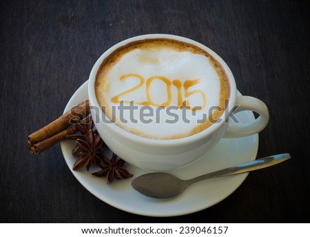 A cup of coffee with foam milk art 2015 pattern - stock photo