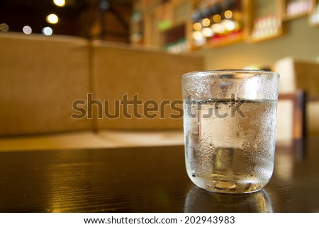 A cup of cool tea in coffee shop - feeling the taste of drink - stock photo