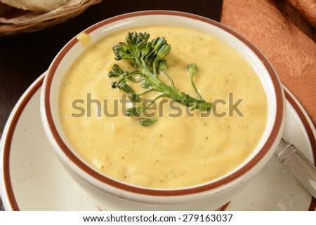 A cup of cream of broccoli soup from a high angle view - stock photo
