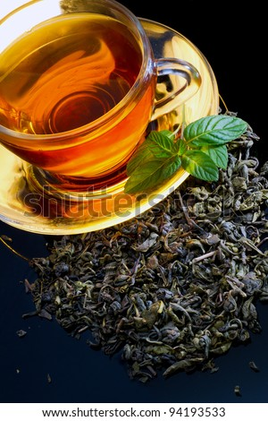 A cup of english green tea with mint - stock photo