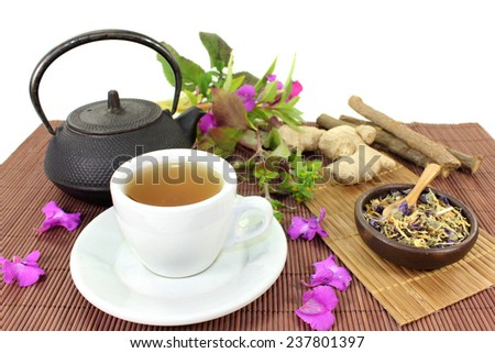 a cup of herbal tea and Chinese medicinal herbs - stock photo