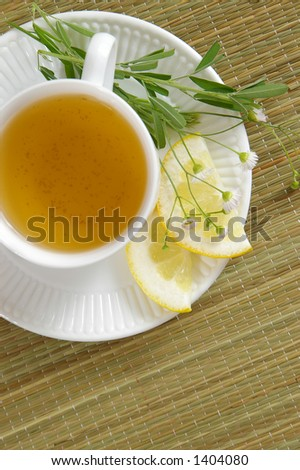 A cup of herbal tea, as viewed from directly overhead. - stock photo