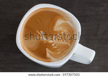 A cup of latte art. - stock photo