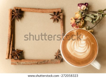 a cup of latte art on brow background, vintage coffee - stock photo