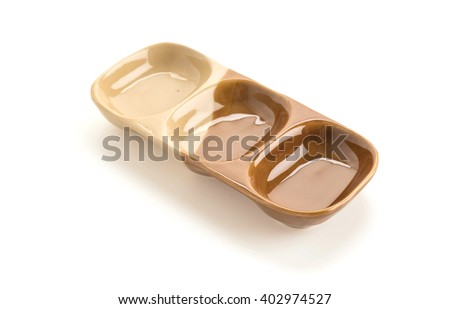 a cup of sauce on white background - stock photo