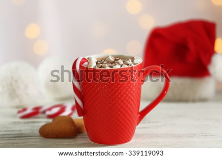 A cup of tasty cocoa and marshmallow on blurred background - stock photo