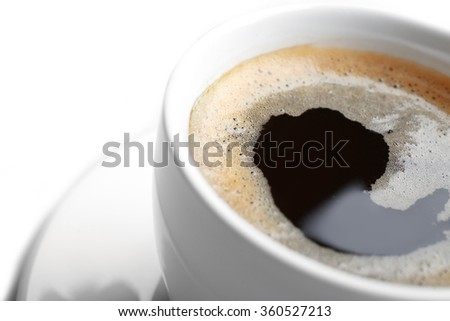 A cup of tasty coffee, isolated on white, close-up - stock photo