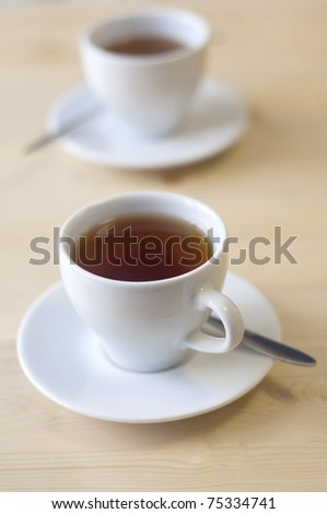 a cup of tea on the table - stock photo