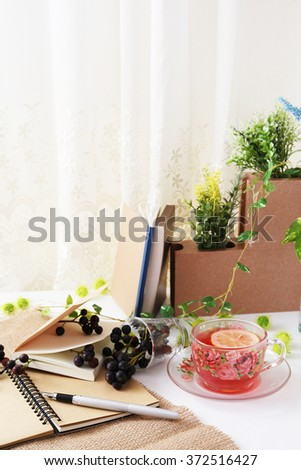 A cup of tea with grapes - stock photo