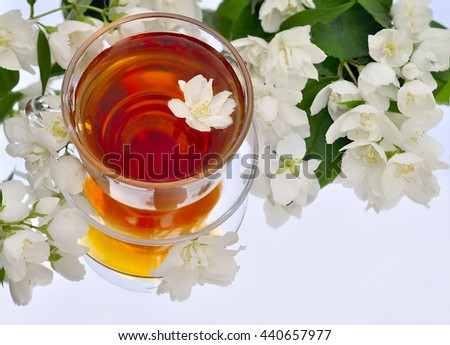 A Cup of tea with Jasmine on a background of mirrors - stock photo