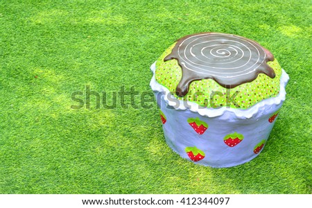 A cupcake chair in the green grass background - stock photo