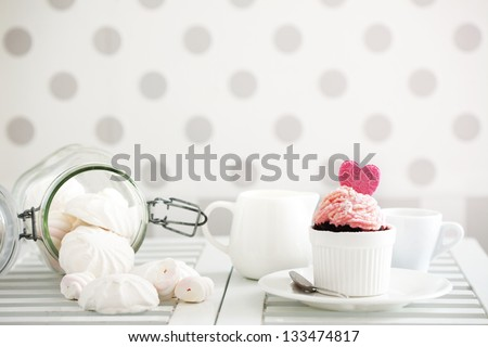 A cupcake on a table lifestyle photo - stock photo