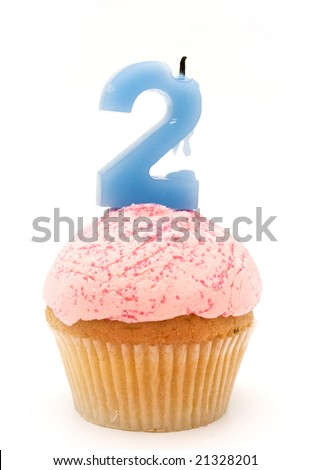 a cupcake with the number two - stock photo