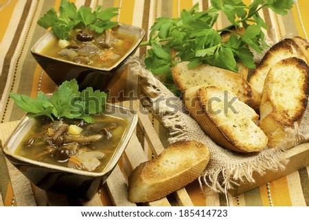 A cups of fresh mushroom soup - stock photo