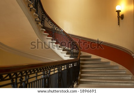 A curved staircase leading up, with a lamp / light on the right side. More with keyword Series002