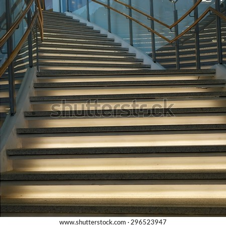 A curved staircase leading upwards with indirect lighting  - stock photo