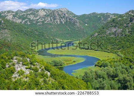 a curvy stretch of Crnojevica River in Skadar Lake National Park, Montenegro - stock photo