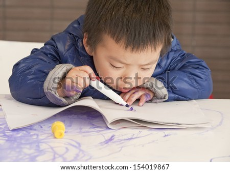 a cute baby is painting - stock photo