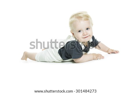 A Cute baby with big blue eyes in denim on white background. - stock photo