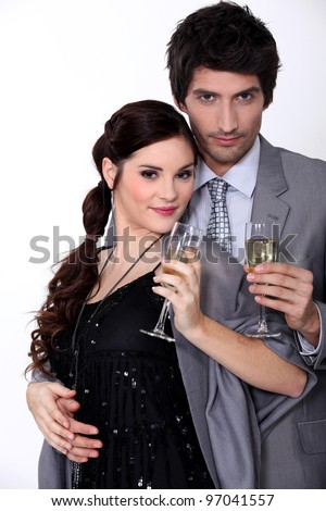 A cute couple drinking champagne. - stock photo