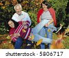 """a cute family is joking in the park. keyword for this collection is """"autumn77"""" - stock photo"""