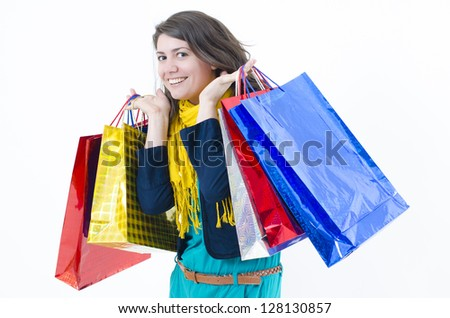 A cute girl coming happy from shopping - stock photo