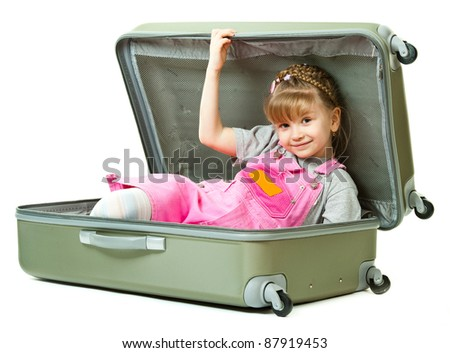 A cute girl playing with a suircase isolated in white background - stock photo