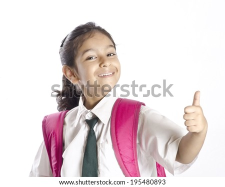 A cute girl showing thumbsup - stock photo