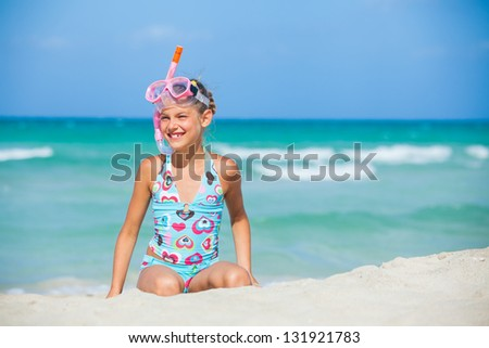 A cute girl wearing a mask for diving background of the sea - stock photo