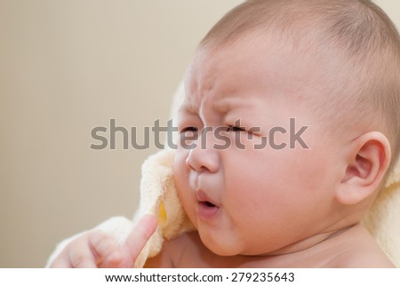 A cute little asian baby with surprise expression. - stock photo