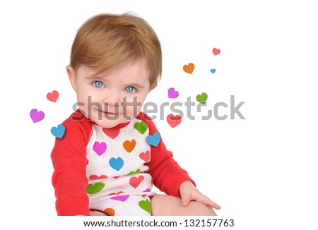 A cute little baby is sitting with hearts from the red clothing floating away on a white isolated background for a love concept. - stock photo
