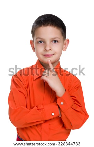 A cute little boy in a red shirt thinks on the white background - stock photo